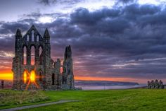 Whitby Abbey, a ruined Benedictine abbey overlooking the North Sea on the East Cliff above Whitby in North Yorkshire, England Beautiful World, Beautiful Places, Beautiful Pictures, Beautiful Sunset, Amazing Places, Places Around The World, Around The Worlds, Dissolution Of The Monasteries, Whitby Abbey