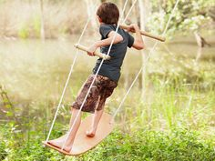 Surf the air on a standing swing. This solid wood swing moves side to side, using balance and making play more fun. Made in the USA.