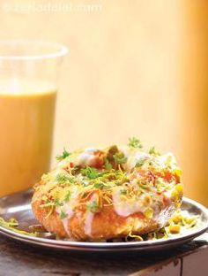Dahi Kachori - a fulfilling snack famous in North India! A delicious snack made using Veg Recipes, Spicy Recipes, Indian Food Recipes, Vegetarian Recipes, Cooking Recipes, Chicken Recipes, Mumbai Street Food, Indian Street Food, Chaat Recipe