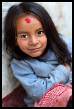 Nepalese girl in Kathmandu, seen on courtyard of the Seto Machhendranath temple