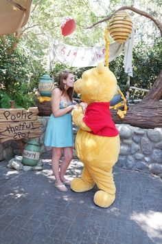 Posing with Winnie the Pooh at Critter Country Disneyland California