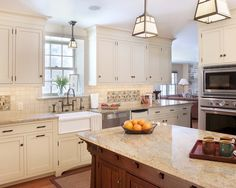Craftsman Kitchen, love these cabinet doors that sit flush within the openings and with exposed hinges and the molding at the tops. Also like the decorative base of the sink cabinet a Lot