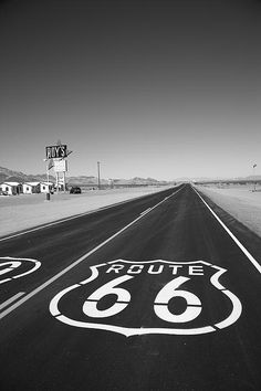 "Route 66 in the Mojave Desert goes on forever. The famous Rt. 66 shield is painted on the old road outside Roy's Cafe in Amboy, California.  ""The Fine Art Photography of Frank Romeo."""