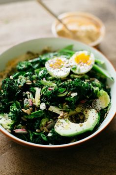 This hummus and greens bowl is the perfect way to get your fiber, fat, and protein all in one delicious salad! It's inspired by Two Hands in NYC.