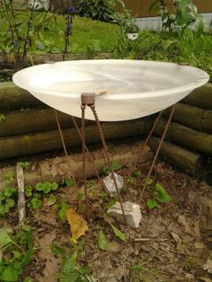 Found a ceiling light fixture by a Dumpster. In under 5 minutes, I repurposed it into a bird bath. Voila! ~Patty K.~