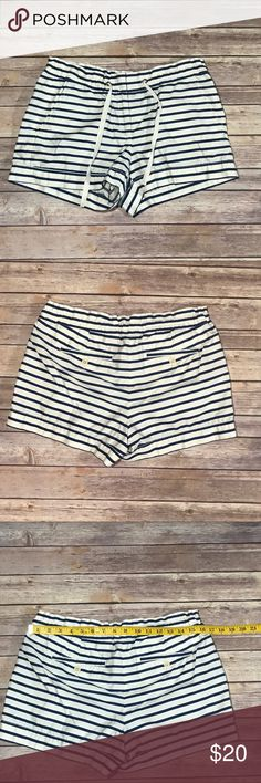 J. Crew, navy and white, nautical shorts- size 6. Adorable, nautical style shorts by J. Crew. Features a navy and white horizontal stripe print, pockets, and an adjustable/tied waist. Excellent used condition- no holes, stains, or pilling. Size 6. Waist and inseam measurements included in the photos. Offers welcomed :) J. Crew Shorts Skorts