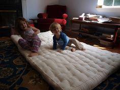 Making a wool mattress.