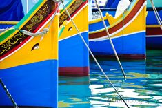 The colourful fishing boats of Marsaxlokk, Malta, called luzzus, are brightly painted in blue, with green, red, yellow and white accents, depending on the boat's town of origin. Most have the eye of Osiris painted or carved on the bow for protection.