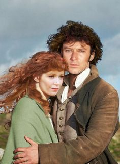 Poldark 1975 and 2015 Mashup: Actress Angharad Rees, Demelza and actor Robin Ellis, Ross from 1975 series in the well known publicity image from the 2015 Poldark Series. Poldark 1975, Poldark Series, Ross Poldark, Robin Ellis, Ross And Demelza, Aidan Turner Poldark, Masterpiece Theater, Bbc Tv, American War