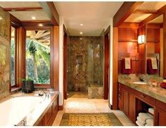 Like the idea that you can soak in the tub while looking out at nature.  Also like the combo of war wood and marble.