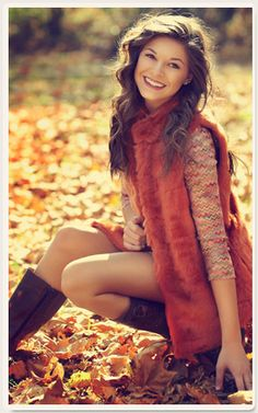 Backdrop is lovely and her choice of colors are great, and sweet smile her personality comes alive like the brilliant fall colors