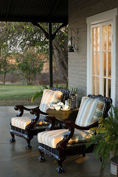 LOVE these chairs! Just wish I had a big wrap-around porch to put them on.