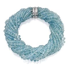 Aquamarine and Diamond Torsade Necklace, Verdura Composed of 12 strands of faceted aquamarine beads measuring approximately 12.0 to 4.5 mm, the clasp accented by round diamonds weighing approximately 1.05 carats