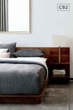 Acacia veneer platform bed integrates headboard nightstands with two cantilevered shelves each—one wide for books, one narrow with discreet cord cutouts for your light/phone/alarm clock. Ledge extends around mattress and hovers over corner block feet. Headboard is just the right height for pillow propping, too. Mattress sold separately. Room Decor Bedroom, Home Bedroom, Modern Bedroom, Bedroom Furniture, Bedroom Signs, Bedroom Rustic, Bedroom Inspo, Bedroom Apartment, Bed Room