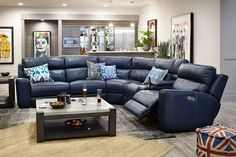 Leather Allure. Bask in ultimate relaxation with the stunning Newport collection. Beautifully dressed in a soft and soothing blue leather upholstery, this sectional includes an easy-to-operate power motion reclining function that allows you to rest in luxury without effort. Comfort is a top priority with this sectional, which features a high back that provides quality support, and the use of memory foam and high-resilience foam ensures you'll relax in extravagance. A zero wall-hugger feature…
