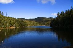 Sterling Pond. A mountain lake accessible only by a 2 mile hike straight up the mountain. Located in the Green Mountains by Stowe, VT #safarivermont