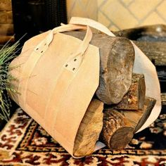 Leather Firewood Carrier.  Natural thick leather with riveted handles allows you to carry substantial wood loads, without leaving a trail of wood chips and debris. Even with sizable logs, the heavy-leather firewood tote provides an apron that will keep your house and hearth areas neat and clean. #firewoodcarrier #logcarrier #leather #firewood