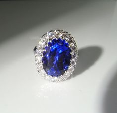 This dazzling ring features a 10 carat loupe clean natural untreated tanzanite in the finest color. This earth mined stone is so clean that even with a microscope there are no inclusions to be found. It is an astonishing stone of museum quality. The beautiful tanzanite is securely set in an exquisite hand made ballerina style setting which rises high off the finger. On the underside of the cluster is a design with fine twists of gold wire and pave set diamonds. This ring is pure…