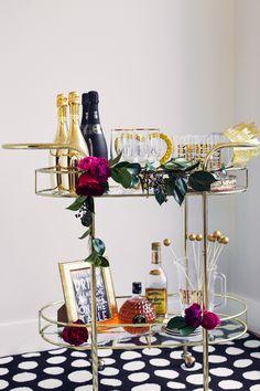 Black & Gold NYE Wedding: bar cart champagne station.