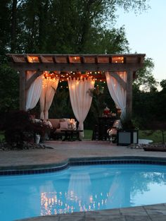 There are lots of pergola designs for you to choose from. You can choose the design based on various factors. First of all you have to decide where you are going to have your pergola and how much shade you want. Cedar Pergola, Wooden Pergola, Outdoor Pergola, Backyard Pergola, Pergola Plans, Backyard Landscaping, Pergola Ideas, Pergola Lighting, Outdoor Bars