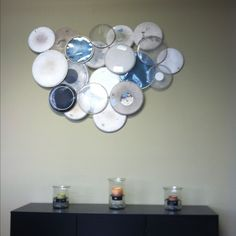 drum-head wall art.  I'm looking to do something like this, but maybe paint them?  Not sure. Any ideas of what to do with LOTS of left over drum heads.