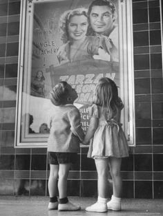 Children looking at posters outside movie theater Photographer: Charles E. Steinheimer San Carlos, California, USA, June © Time Inc. I like how he's holding her hand. Vintage Photographs, Vintage Photos, Outside Movie, Old Love, Life Magazine, Best Photographers, Perfect Photo, Image Photography, Vintage Children