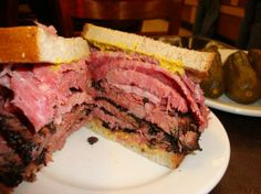 Pastrami and Corned Beef Sandwich New York Deli style.  I like mine made with French bread, thousand island salad dressing, and Swiss cheese. Oh I have died and gone to heaven!!!