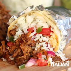 Chipotle's famous barbacoa is the Mexican barbecue of my dreams.  With this amazing copycat recipe (made in a crockpot) it can be a reality for you.  Seared beef is slow cooked in a spectacular spicy adobo sauce and combination of flavors that create the perfect moist and tender Mexican shredded beef.