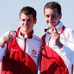 Commonwealth Games '14: Winners  England's Alistair and his brother Jonathan celebrate with their medals following the men's triathlon race at the 2014 Commonwealth Games in Glasgow.