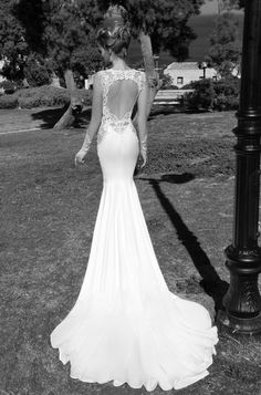 #GaliaLahav -- Alora is a heart shaped open back with large antique lace on the sides giving a skin illusion. Multi-textured train and sexy body hugging silhouette. Enclosed lace at back neckline defining the beautiful opening which is lined with antique lace as well.