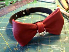 Locking leather bowtie collar.  Ridiculously awesome.  I want to buy one for The Boy to wear with formal attire.  Made to order, multiple color options.  $60