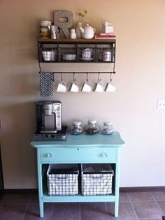 coffee bar set up against small wall between kitchen and living room.
