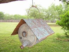 Photo: Welcome your new feathered friends in style.  take an old gasoline can that has been thoroughly cleaned out and make a tin roof.  You are ready to welcome your new neighbors.