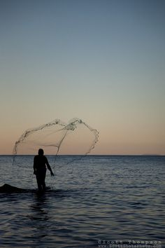 """Old Man Tossing Net 2"" - This old man tossing a fishing net was photographed in Puerto Vallarta, Mexico."