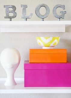style the media unit with brightly colored lacquered or fabric covered boxes