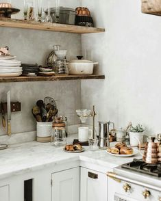 Inspiring white kitchen decorating ideas from Beth Kirby's glorious modern farmhouse kitchen. Rustic decor with wood shelves, marble countertops, and white painted cabinets. Home Kitchens, Cheap Home Decor, Kitchen Remodel, Kitchen Design, Kitchen Decor, Kitchen Countertops, Kitchen Marble, Kitchen Interior, House Interior