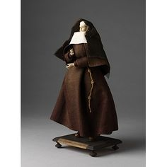 Capuchine Nun; Capuchin Poor Clare    Object:  Ecclesiastical figure    Place of origin:  France (possibly, made)   germany (possibly, made)   Netherlands (possibly, made)    Date:  18th century (made)    Artist/Maker:  Unknown (production)    Materials and Techniques:  Figure made of tow and wax, dressed in linen and woollen materials.    Credit Line:  Given by Mr. G. Smith    Museum number:  1212:15-1905    Gallery location:  In Storage