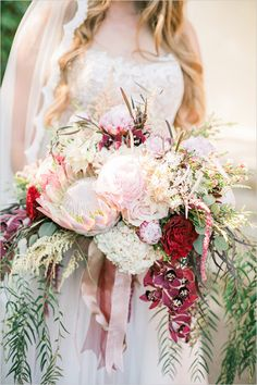 Bohemian bouquet: included roses, hydrangea, proteas, peonies, and orchids