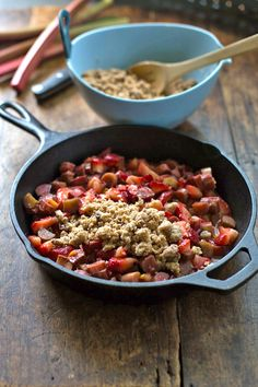 This paleo strawberry rhubarb crisp was a total hit with my husband who had no idea it was anything different than the original. Yummy! #glutenfree #paleo #recipe #yum #dessert | pinchofyum.com