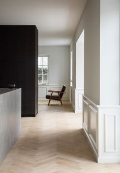 Renowned Danish architect Poul Henningsen is believed to have once owned this house in Copenhagen, which local studio Norm Architects refurbished by opening up the interior to create bright rooms containing dark and tactile bespoke furniture.