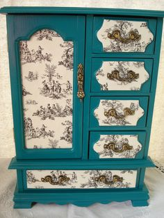 Vintage Hand Painted And Decoupaged Teal Toile Upcycled Jewelry Box. $65.00, via Etsy.