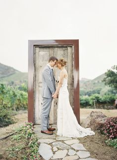 Love, LOVE this freestanding door in the middle of nowhere. Represents bride & groom walking through the door to a new life. So cool!