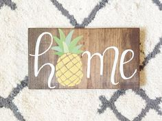 Rustic wood HOME sign with pineapple... which means Welcome