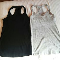 Bundle of work out tops size small Bundle of work out tops size small in excellent condition. Cotton ribbed 3rd pic is of it inside out. It has supported top inside Champion Tops Tank Tops