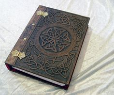 carved, wooden bookcover