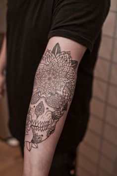 geometric flower skull. filled in with color and larger spaces in flower