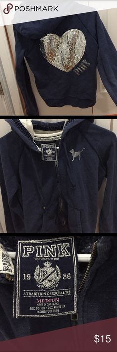 PINK Victoria's Secret  zip up with glitter Pink Victoria's Secret dark blue zip up with heart glitter on back, missing a few pieces of glitter but you can't notice when you are wearing it. PINK Victoria's Secret Tops Sweatshirts & Hoodies
