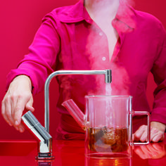 QUOOKER. An ingenious invention that provides 100°C boiling water literally at the turn of a tap. Great for speeding up tea and coffee making, cooking, sterilizing and cleaning. Very efficient and with good safety features. www.quooker.co.uk