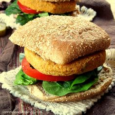 Buffalo veggie burgers made by blending quinoa and chickpeas with spicy cayenne pepper sauce.