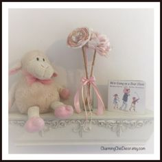 A personal favorite from my Etsy shop https://www.etsy.com/listing/234155914/pink-and-gold-nursery-decor-girlss-room